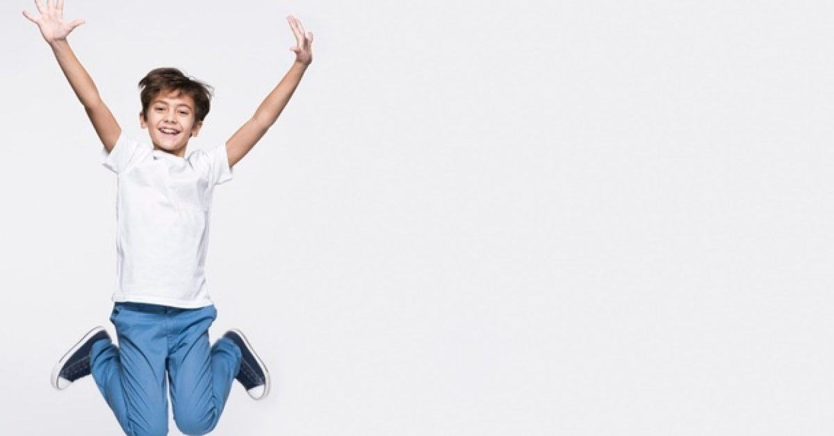happy-young-boy-jumping-with-copy-space_23-2148414468