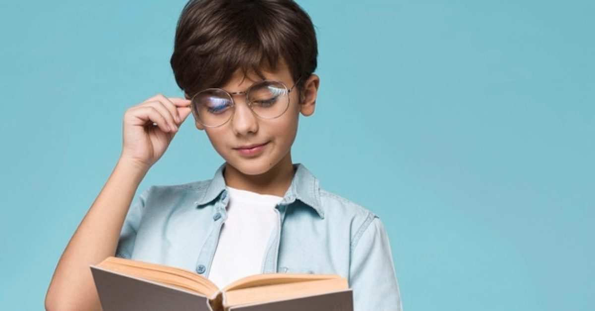 young-boy-reading-with-copy-space_23-2148414552